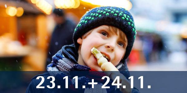 Kind auf Weihnachtsmarkt